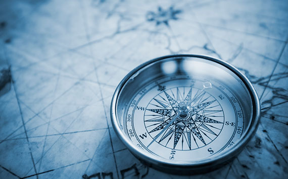 Logistics themed photo - Compass on a map